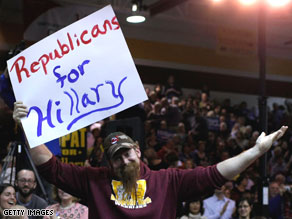  A republican supporter of  Hillary Clinton holds a sign during a campaign rally in Westerville, Ohio
