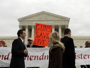A pro-gun advocate holds up a sign outside the Supreme Court in Washington, as the court heard arguments in an attempt to overturn the District of Columbia&#039;s firearms ban. The District of Columbia is asking the Supreme Court to preserve the capital&#039;s ban on handguns in a major case over the meaning of the Second Amendment&#039;s right to keep and bear arms.