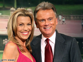 Wheel of Fortune hosts Pat Sajak and Vanna White.