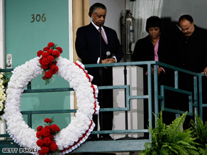 Martin Luther King III and his sister Bernice observe a moment of silence with the Rev. Al Sharpton at 6:01pm, the moment when Martin Luther King Jr. was shot on the balcony of the Lorraine Hotel, on the 40th anniversary of his assassination.