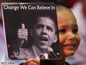 Three-year-old Dusten Washington holds a fan supporting Democratic presidential hopeful Sen. Barack Obama.