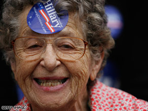 A woman shows her support for Hillary Clinton during a campaign rally in Pittsburgh.