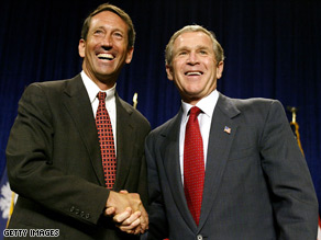 Mark Sanford poses for a picture with President Bush.