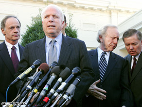 Sens. Carper, Lieberman and Graham stand behind John McCain at a press briefing.