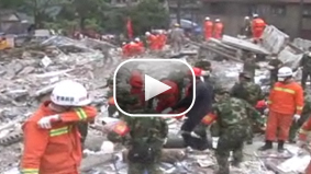 CNN's John Vause reports on the heartbreaking task of looking for survivors of China's big earthquake.