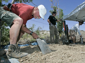 Investigators and scientists search for evidence at the Barker Ranch in Death Valley