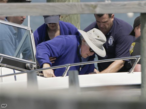Sen. Kennedy is helped into a boat as he heads out sailing a week after his surgery.
