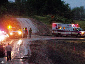 An ambulance transports people injured by a tornado that touched down a Boy Scout camp near Little Sioux, Iowa, Wednesday evening.