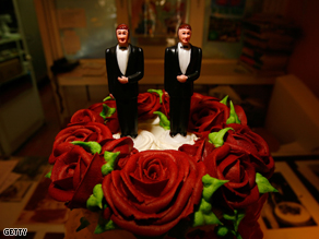 Same-sex wedding cake topper figurines are seen at Cake and Art in West Hollywood, California