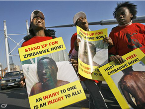 Zimbabweans and South Africans demonstrate against election related violence in Zimbabwe on Nelson Mandela Bridge in downtown Johannesburg, South Africa