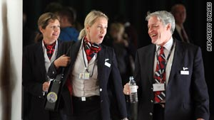 British Airways cabin crew attend a union meeting to discuss possible strike action.