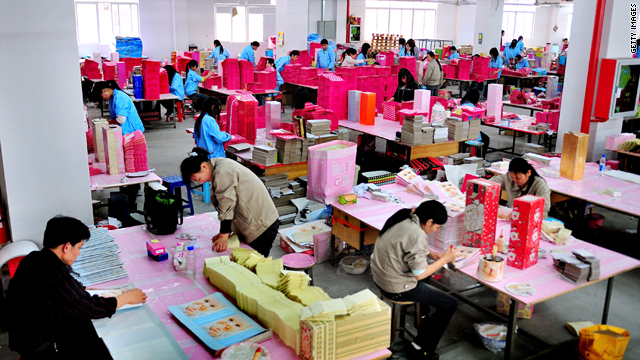 Staff work at the Pinghu Paper Factory on March 9, 2009, in Shenzhen, Guangdong Province, China.
