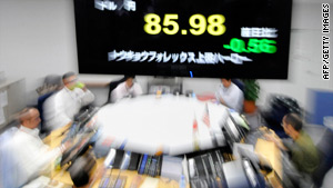 Currency traders in Japan where last week the yen hit 14-year highs against the dollar.
