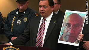 Morris County Prosecutor Robert Bianchi holds up a photo of Jose Feliciano.