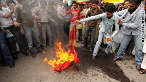 Demonstrators angry at cartoons in a Danish newspaper burn the Danish flag in Pakistan last year.