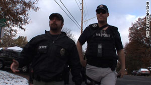 Parole Officer Dean Warren, left, and Deputy U.S. Marshal Erick Helsing go after sex offenders.