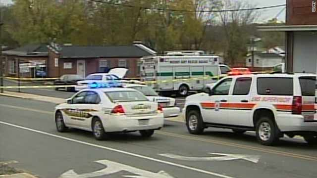 Emergency officials in Mount Airy, North Carolina, respond to the scene of a shooting where four men were killed.