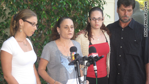 Sherry Jarvis apologizes Wednesday with her daughters, Elyse, left, and Danielle, and her husband, Denver.