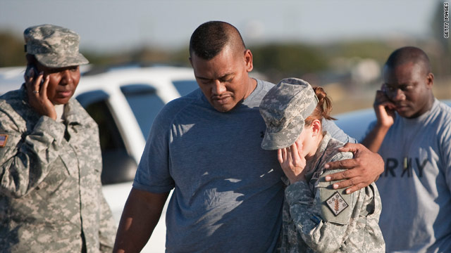 Sgt. Fanuaee Vea, left, embraces Pvt. Savannah Green outside Fort Hood in Texas after Thursday's shootings.