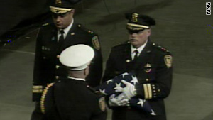 Officer Tim Brenton, who was gunned down on October 31, was laid to rest Friday in Seattle, Washington.