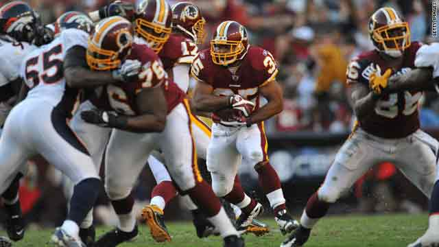 The Washington Redskins team, here facing the Denver Broncos on Sunday, had battled a lawsuit over its trademark since 1992.