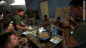 U.S. Marines eat chicken and rice at a base in Farah Province, Afghanistan.