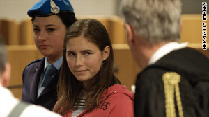 American student Amanda Knox looks at one of her lawyers before trial events Saturday in Perugia, Italy.