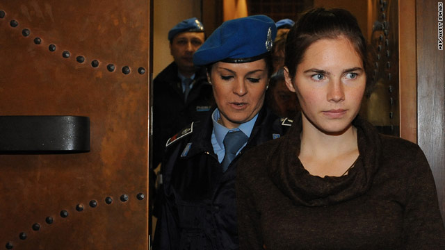 Amanda Knox is escorted into the courtroom Wednesday in Perugia, Italy. She is accused of killing her roommate.