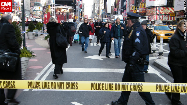 A suspect fired two shots at a New York police officer, before being shot and killed in New York's Times Square.