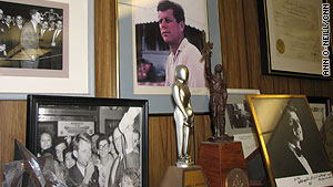 Photos of his years with the Kennedys are displayed in Morgenthau's office.