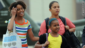 Malia, left, and Sasha Obama received seasonal and H1N1 flu shots last week, the White House says.