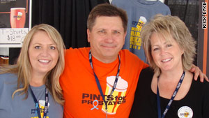 Rick Lyke with daughter Brhea (left) and wife Sandy (right).
