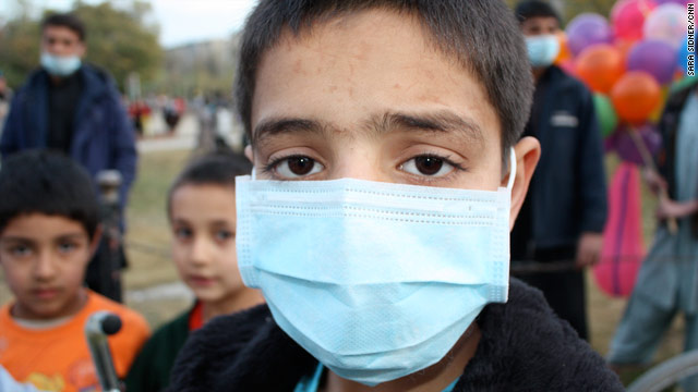 Ramin Nudratt, 11, will be off school for a few weeks as Afghanistan declares a H1N1 public health emergency.
