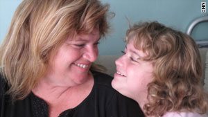 Hayli Murphy, with mom Julie, tested negative for the H1N1 virus twice despite being infected.