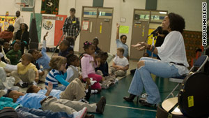 Palmer performs for students in an after-school program in Atlanta. (Photo: Sean Wright for Threshing Floor Academy)