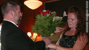 John Comstock surprises his wife, Cindy, on their 25th wedding anniversary.