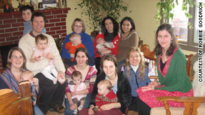 Robbie Goodrich, at left holding daughter Julia, with some of the moms who have nursed Moses, in center back.