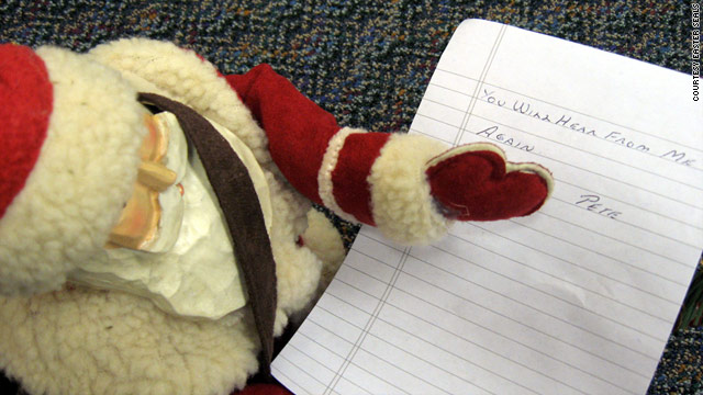 "An early gift from ""Pete"" included a wooden Santa and note reading, ""You will hear from me again."""
