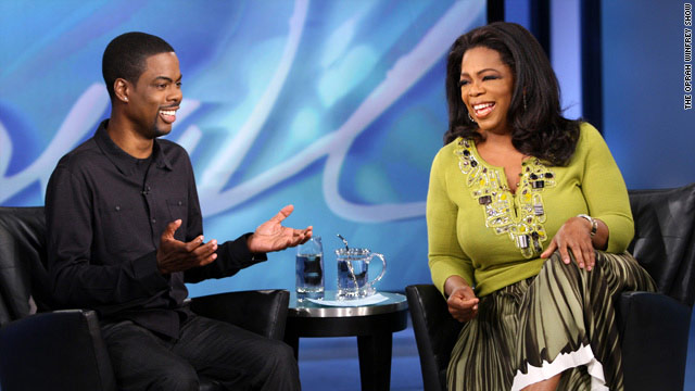 "Comedian Chris Rock tells Oprah Winfrey that his hands were ""thirsty"" to touch women's hair."