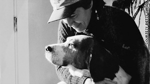 Rita Mae Brown, with one of her many dogs, points out that in the animal world, you pull your own weight.