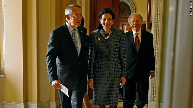 Senate Majority Leader Harry Reid walks out of his offices with Sen. Olympia Snowe, a Republican,  and Sen. Joe