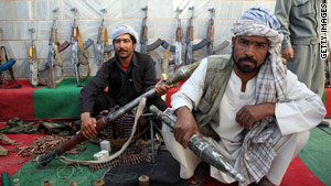 Taliban fighters lay down their weapons as they surrender to the Afghan government in western Afghanistan.