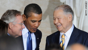 Sen. Harry Reid, left, and President Obama present the medal to former Sen. Edward Brooke on Wednesday.