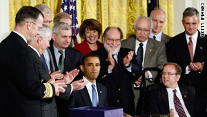 President Obama signs the $680 billion defense spending bill that includes the hate crimes law.