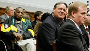 From left, former players Willie Woods and Brent Boyd and NFL Commissioner Roger Goodell at Wednesday's hearing.