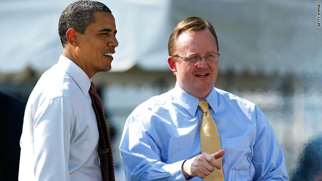 President Obama, left, and spokesman Robert Gibbs talk at a White House event in June.