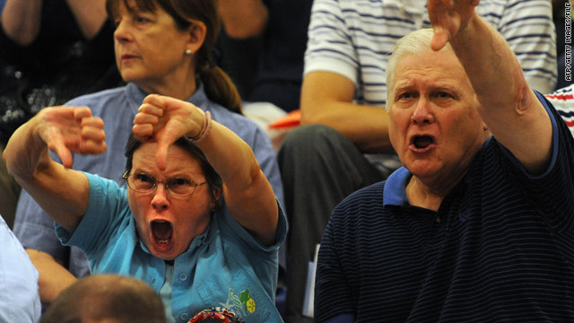 Two people react at a health care town hall meeting in Reston, Virginia, in August.