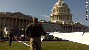 Protesters unfurl a copy of the House health care reform bill during a rally Saturday outside the U.S. Capitol.