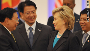 Secretary of State Hillary Clinton, shown with world leaders in Singapore on Sunday, says the Afghan mission is intact.