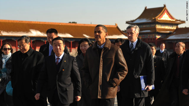 Chinese officials give President Obama a tour of Beijing's Forbidden City on Tuesday.